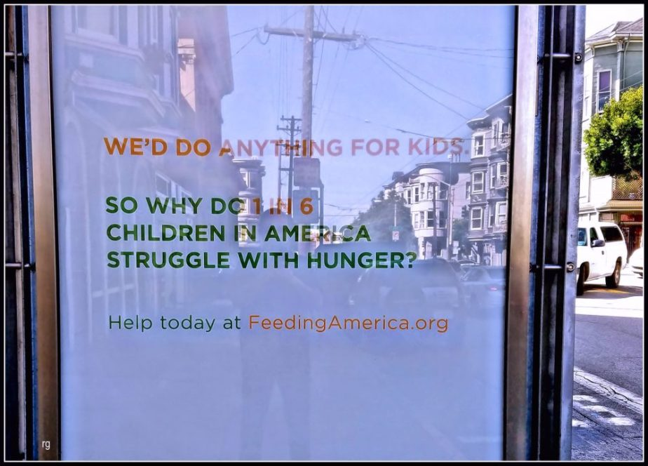 Photograph of an advertisement for the San Francisco Food Bank at the Haight and Fillmore muni stop in San Francisco