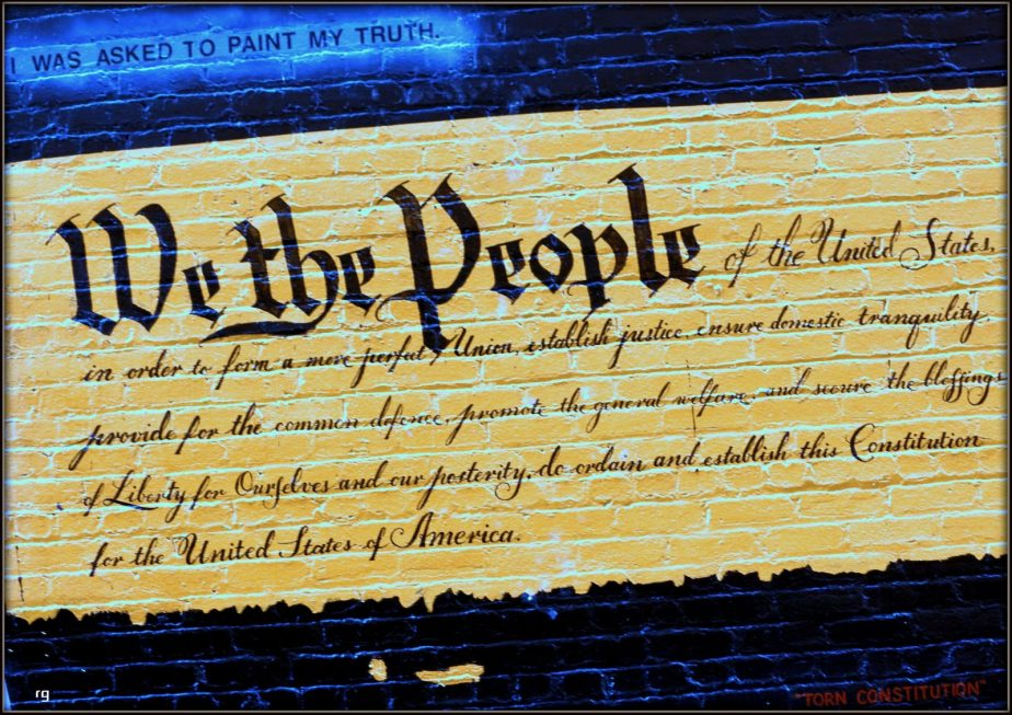 Photograph of a san francisco wall mural of the opening paragraph of the constitution of the united states