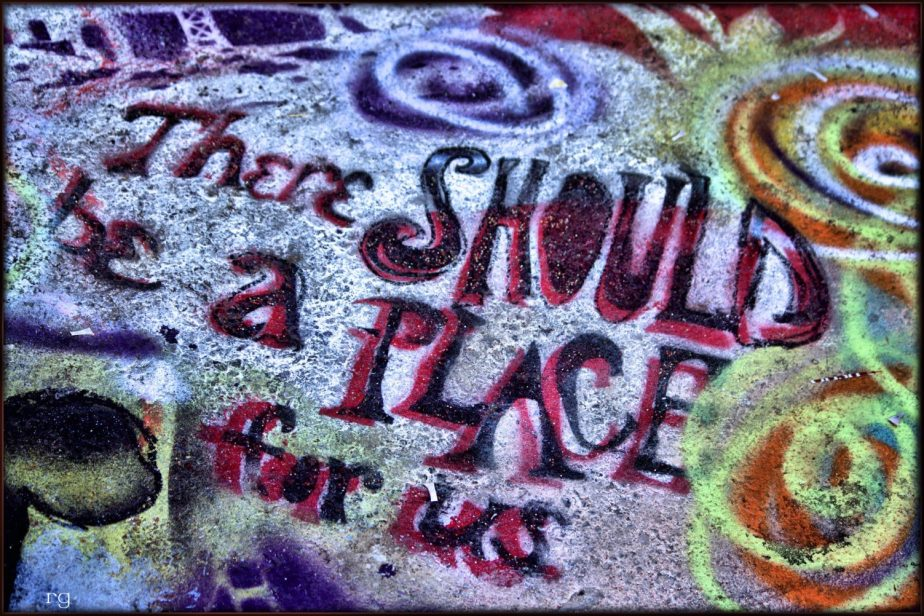 Street graffiti that reads 'There should be a Place for us