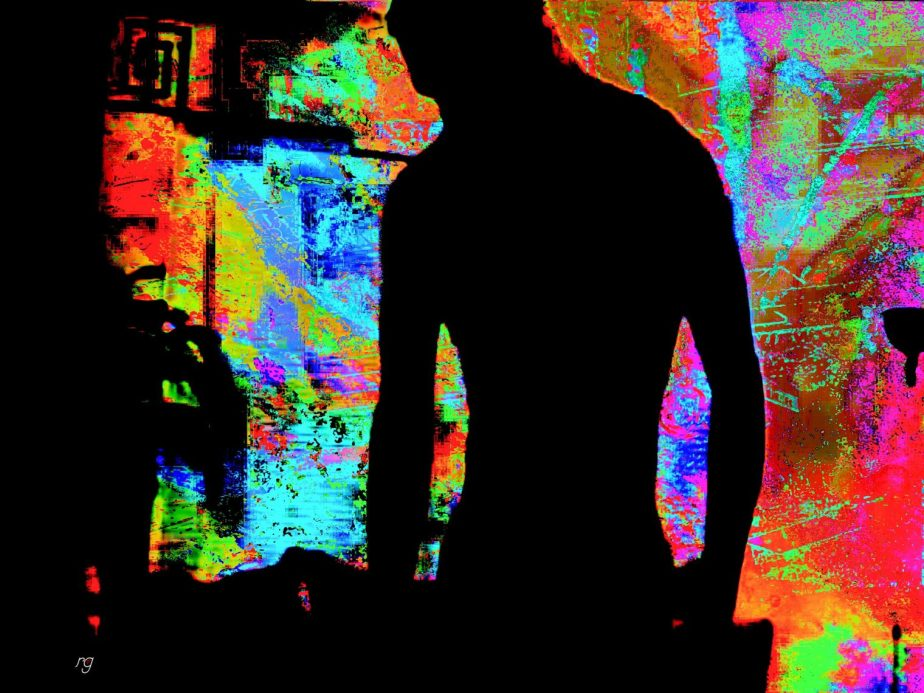 Surrelaist image of a man in shadows infront of a colorful window based on a still shot from a home movie