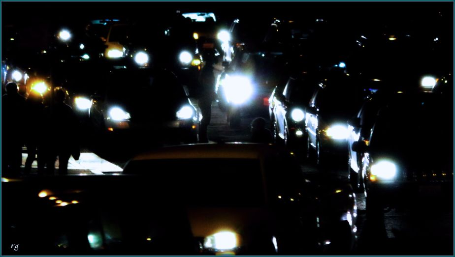 Nightshot of traffic on a busy intersection on Geary Street in San Francisco