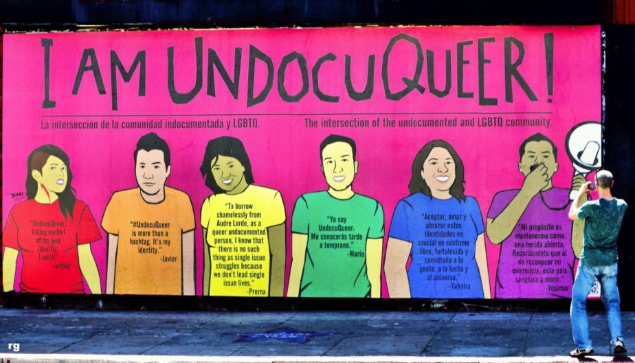 photographer taking a photograph of a Mural in San Francisco's Mission District of a mural drawn by LGBTQ immirants who are undocumented