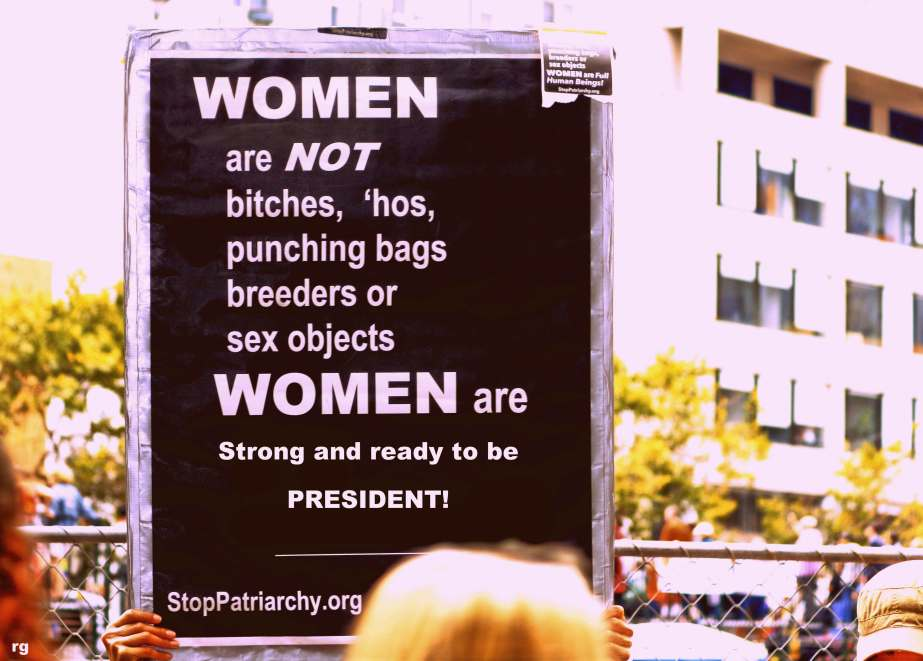 photo of a san francisco protest sign that reads women are not bitches and hoes