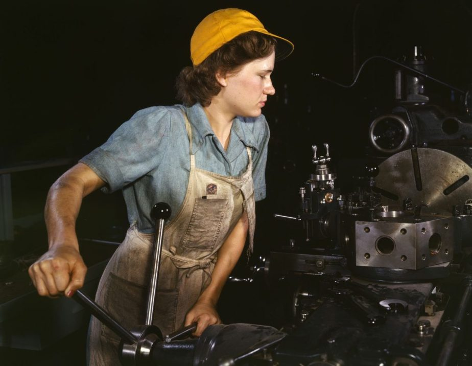 Photograph of a woman working in a factory in the 1940's