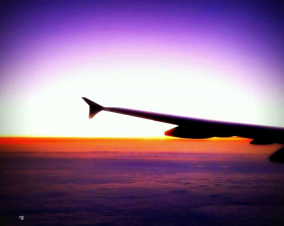Sanpshot of the wing of a plane against a surreal horizon taken with my Samsung