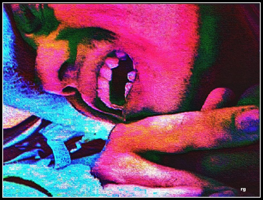 A heavily processed video grab from an amateur movie which shows a young man in pain. The colors of vivid pinks and blues