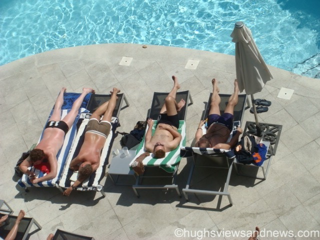 Sunbathers around the pool
