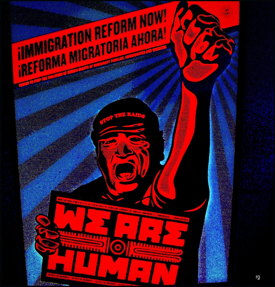 Photo-shopped photograph of a pro immigrant sign in a shop window that reads, We are Human