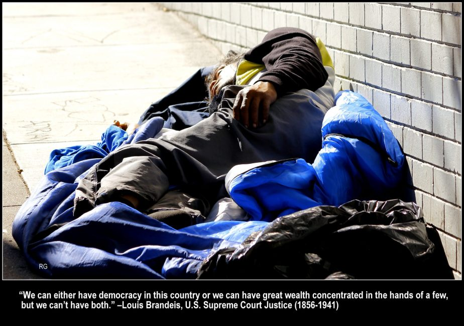 Photograph of a homeless man asleep on a San Francisco sidewalk