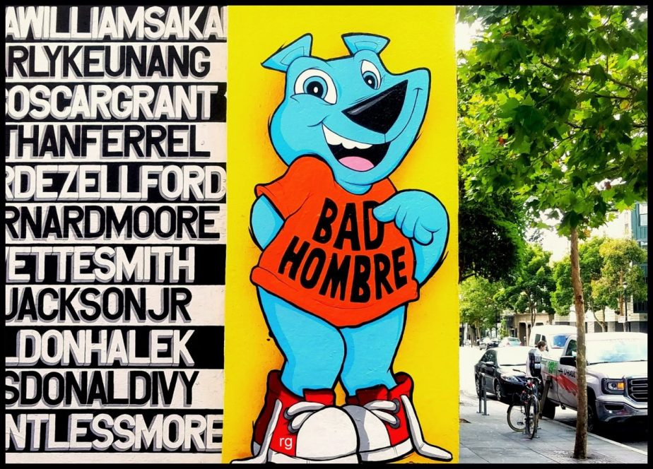 Photo of a graffiti mural in San Francisco of a cartoon bear wearing a tee-shirt that reads 'Bad Hombre'
