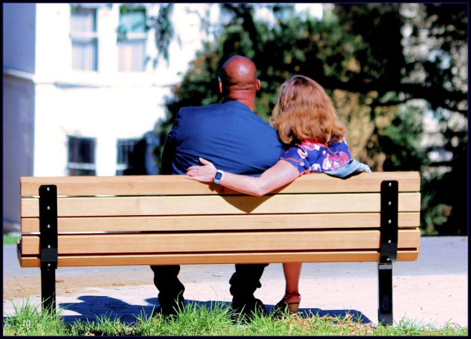 Photo of an mixed race couple in Alamo Square Park