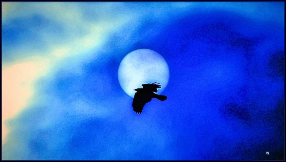 Photo of a raven crossing a full Moon for Halloween