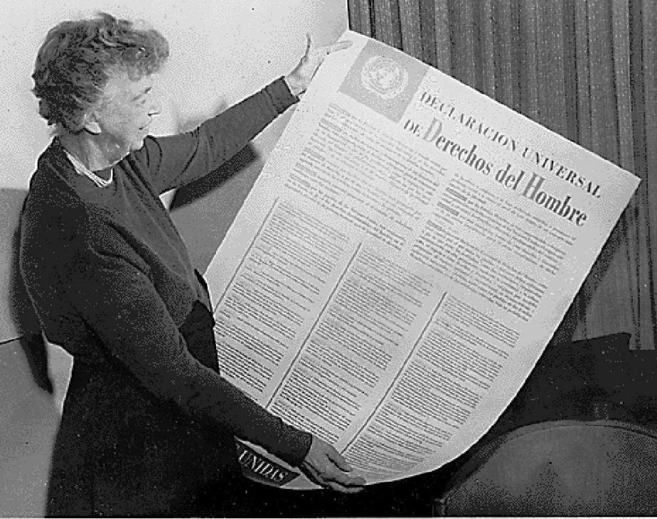 Public domain photo of Eleanorr Roosevelt hoding a Spanish Language copy of the Universal Declaration of Human Rights