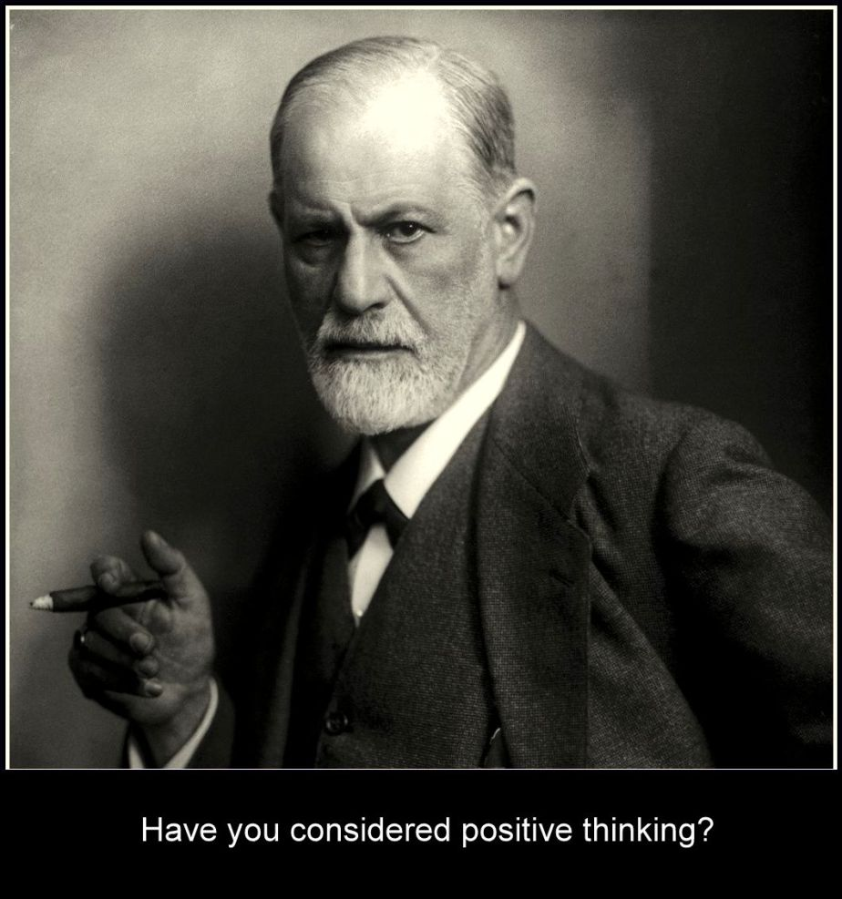 a 1922 photograph of Freud with a caption that points out the absurdity of expecting people with serious mental illnesses to get well with the power of positive thinking