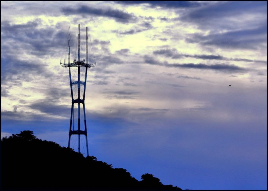 A photograph of San Francisco's Sutro Tower at Sunset from Alamo Square Park