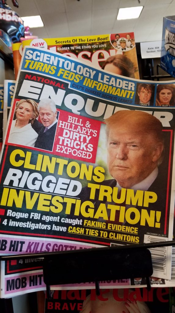 A photograph of the front page of the National Enquirer, December 20, 2017 that reads Clintons Rigged Trump Investigation