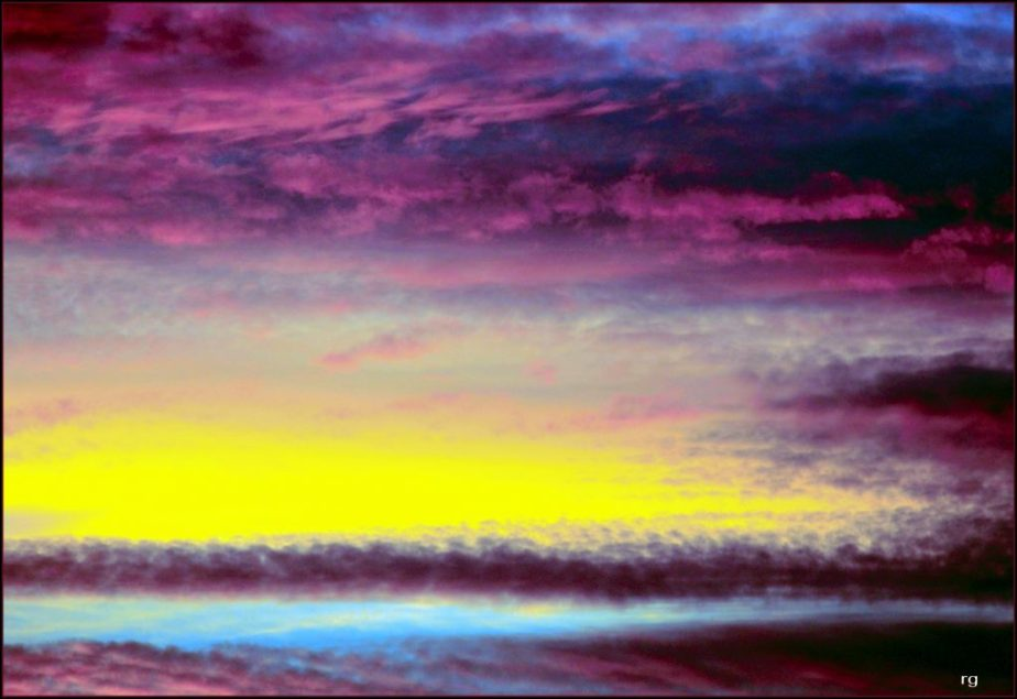 Digital painting of a purple, yellow and blue sunset as seen from a plane
