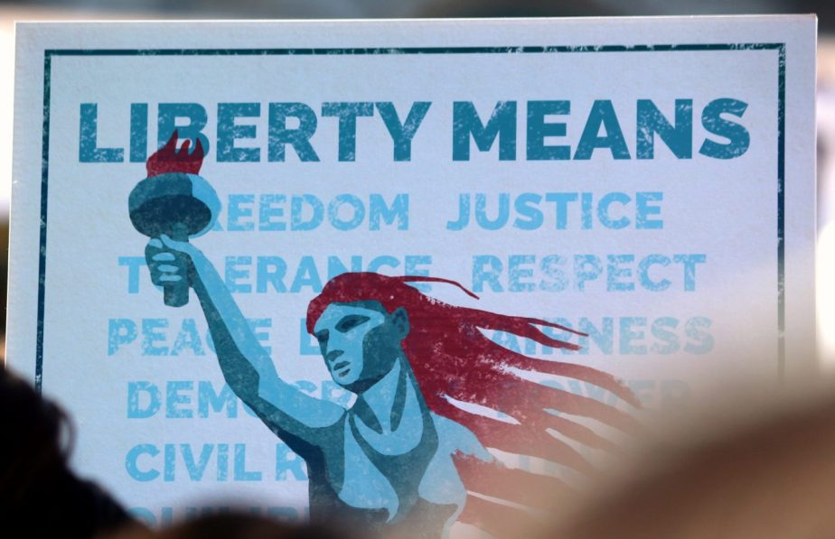 Scenes from the 2018 Women's March in San Francisco - a sign that reads Liberty means freedom justice respect tolerance