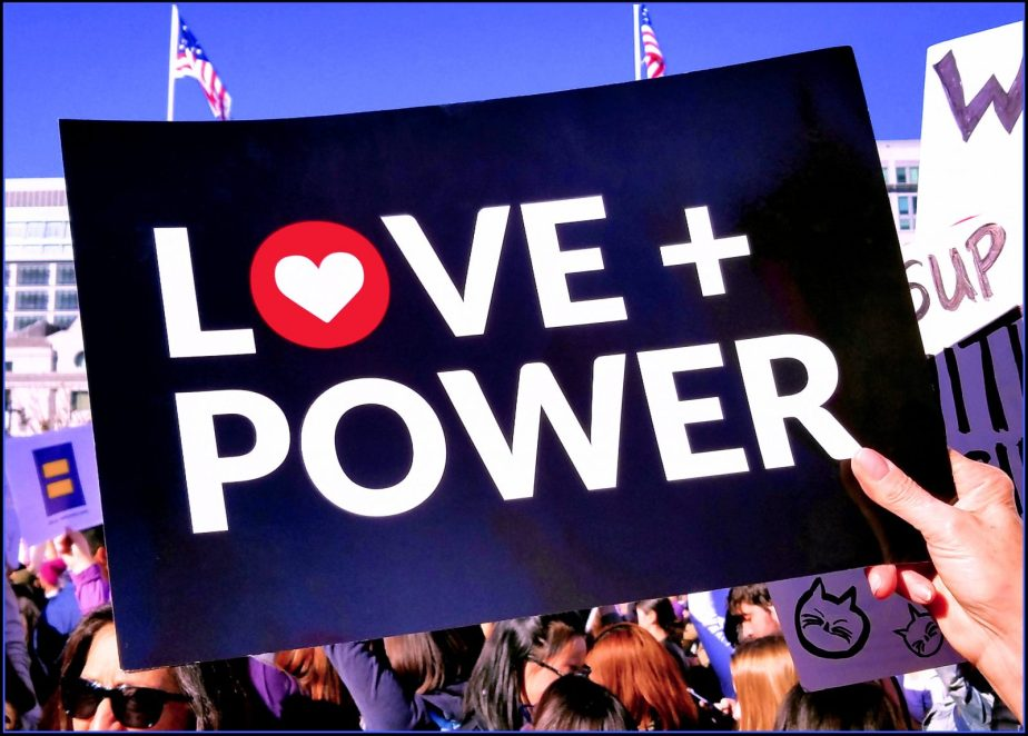Photograph of a sign at the Women's March 2018 that reads: Love plus Power