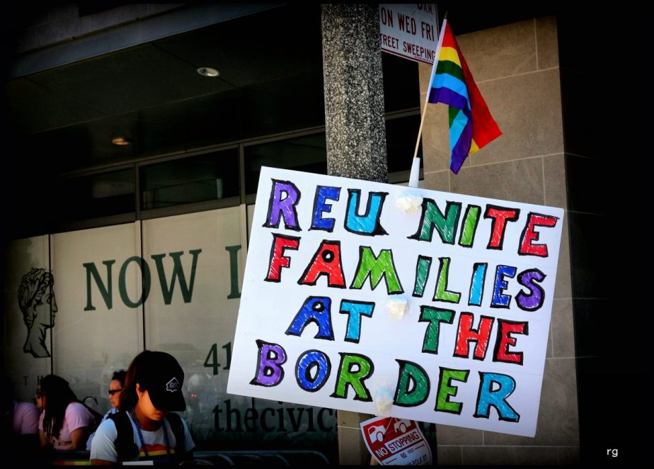 A photograph of a sign at the 2018 Pride parade in San Francisco that reads Reunite Families at the Border
