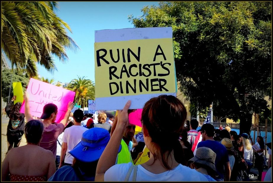 sign from a political rally thaty reads Ruin a Racists Dinner