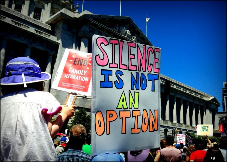 A sign from a 2018 political Rally that reads Silence is not an option