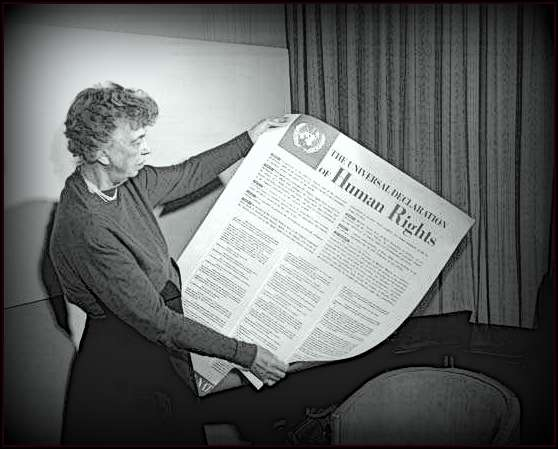Eleanor Roosevelt holds up the Universal Declaration of Human Rights.