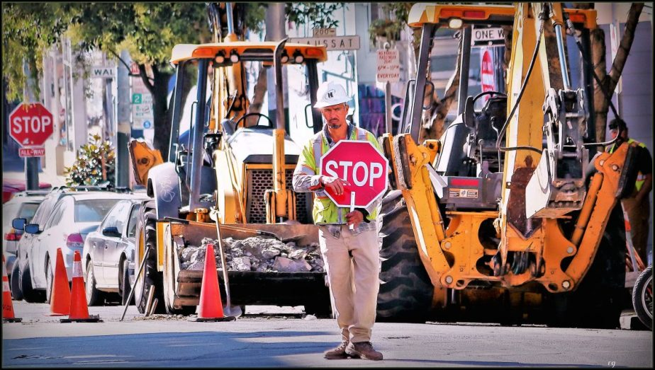 A San Francisco construction worker directs traffic