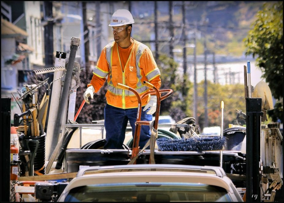 A San Francisco Construction worker stands in the back of his truck.