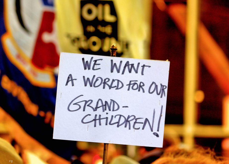 a sign that reads We want a World for Our Grandchildren at the Rise For Climate March in San Francisco