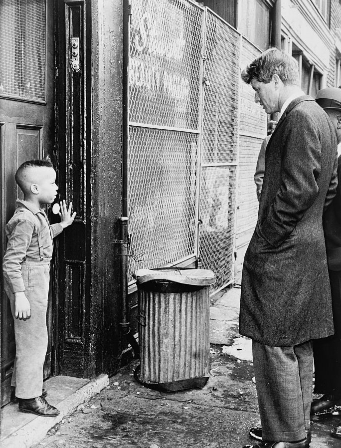 Robert Kennedy discusses school with young Ricky Taggart