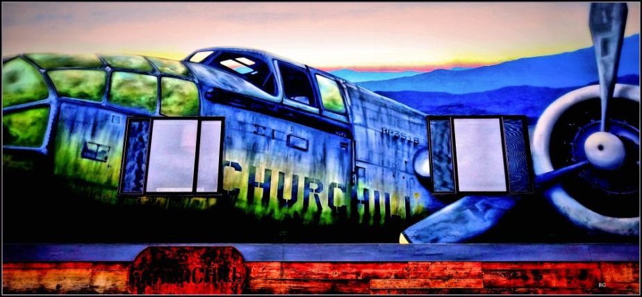 Samsung photograph of a wall mural on a building on Church Street at Market in San Francisco. The mural depicts a World War Two military aircraft with the name of Winston Churchill on the hull
