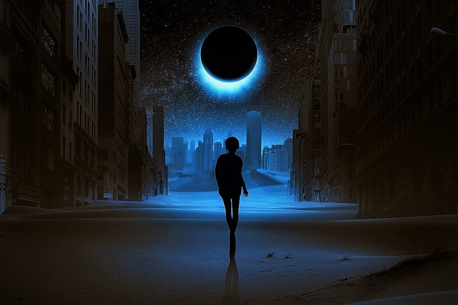 a pixelbay image of a boy alone in an abandoned city during a solar eclipse