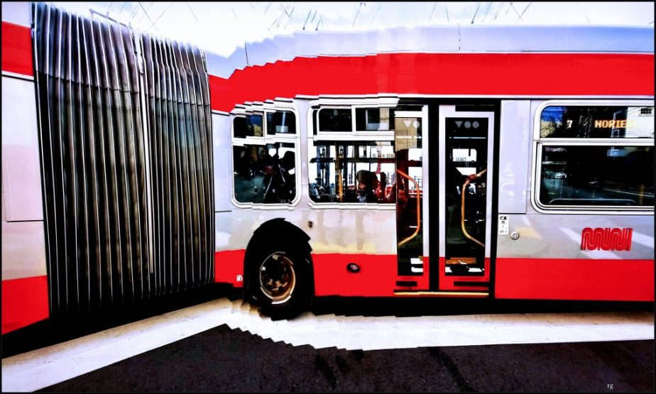 A photograph of a San Francisco Bus digitally altered to make it look bent in a V