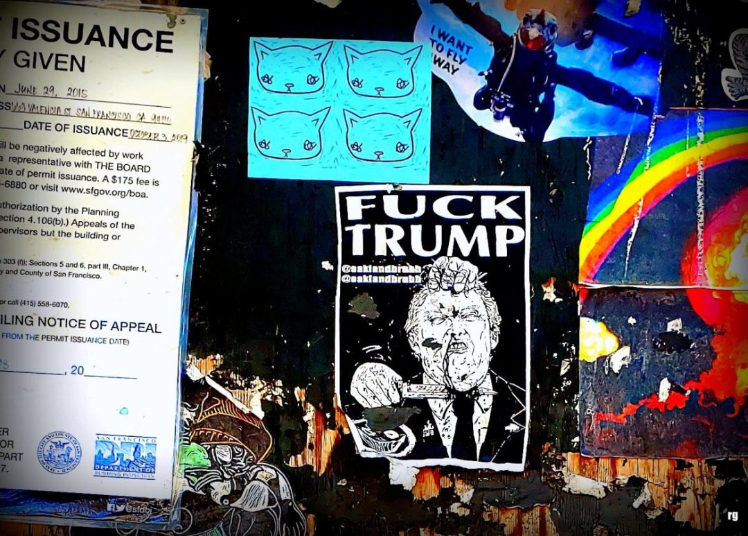 A photograph of stickers on Valencia Street